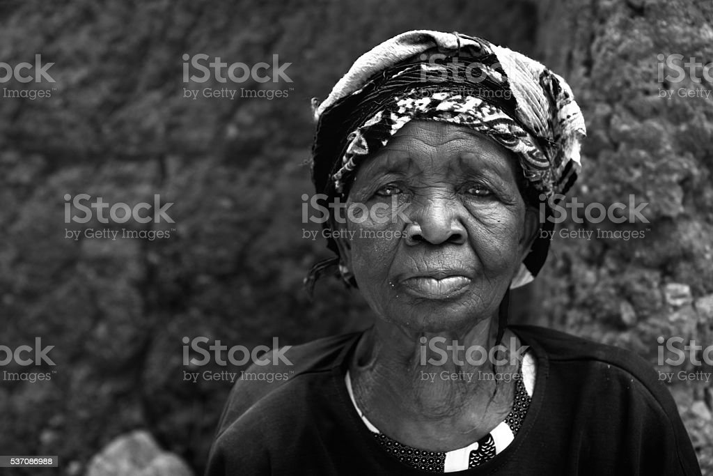 Aged Togolese woman with headscarf stock photo