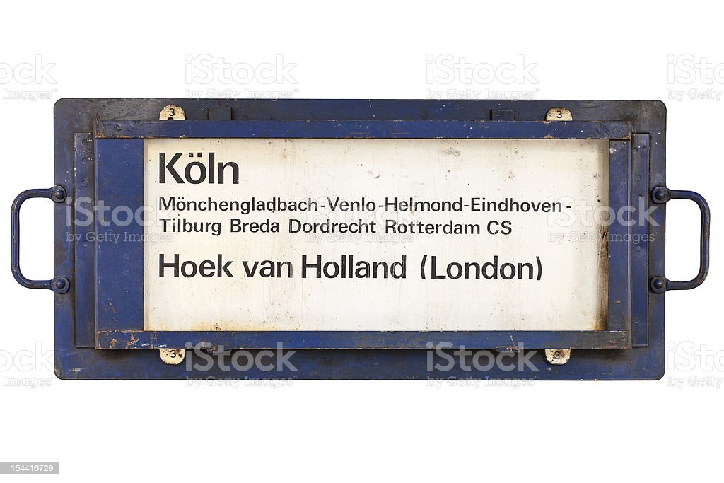 Aged train destination sign for Holland and Germany royalty-free stock photo