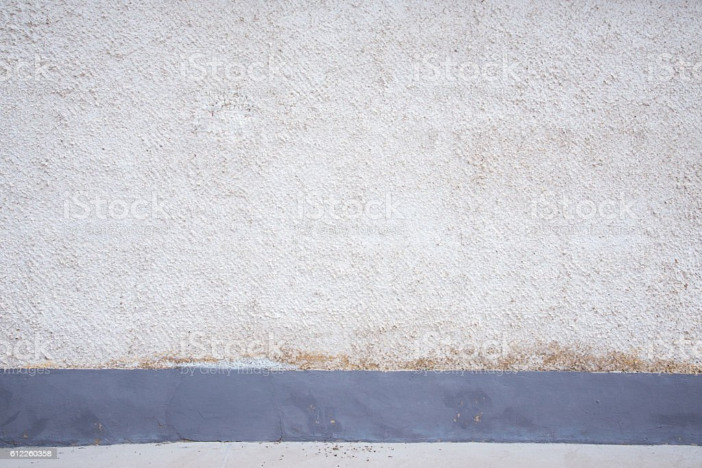 aged wall with blue strip stock photo