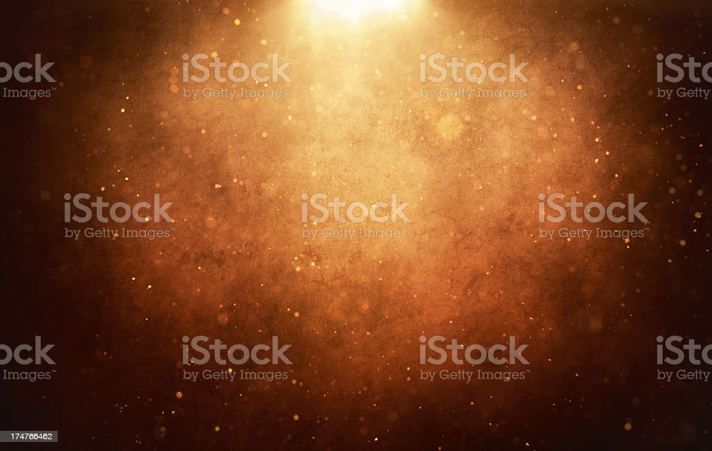 Aged wall with light and flying particles stock photo
