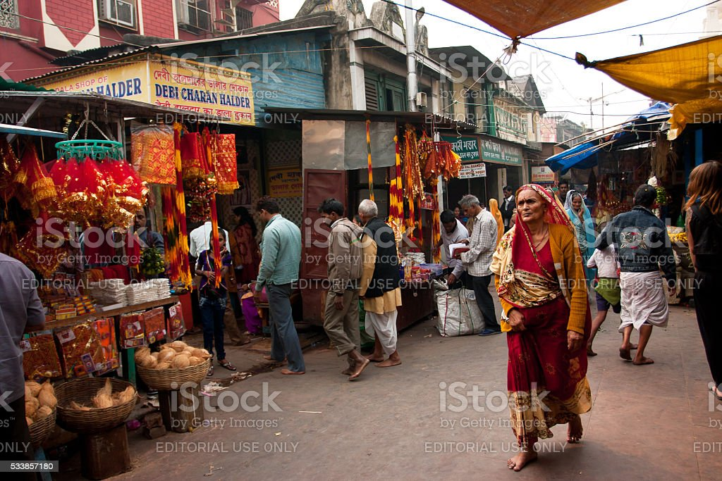 Aged woman rush in India. stock photo