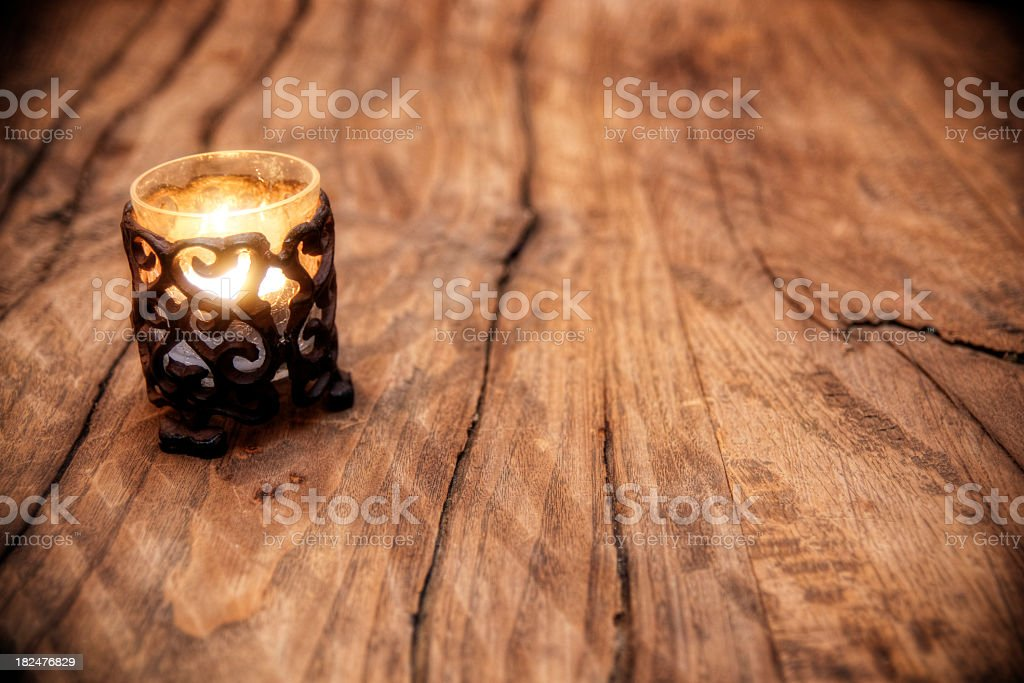 Aged Wood Tabletop and Candle stock photo