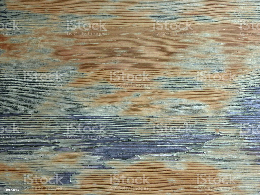 Aged wood with blue paint coming off royalty-free stock photo