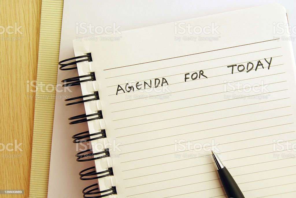 'Agenda for today' written on a spiral pad royalty-free stock photo