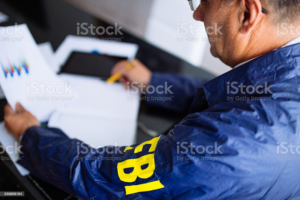 Agent at his office desk stock photo