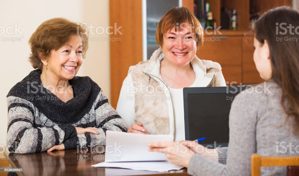 Agent consulting cheerful women stock photo