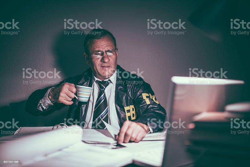 FBI agent drinking coffee stock photo