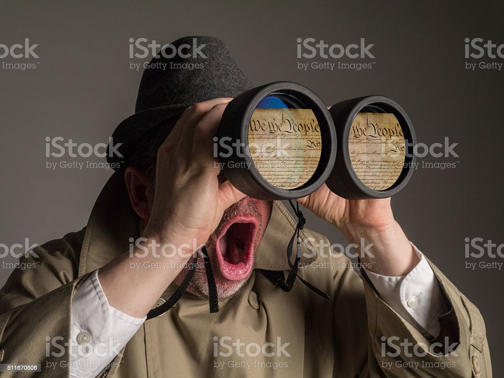 NSA Agent Shocked to See U.S. Constitution Through His Binoculars stock photo