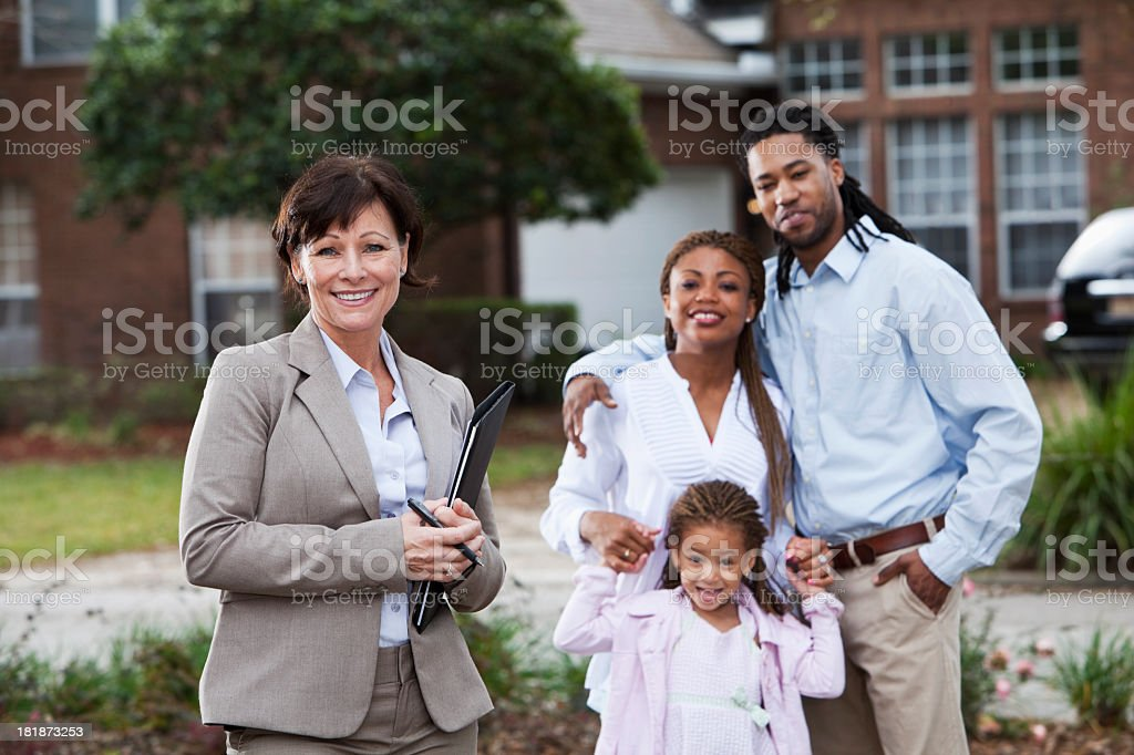 Agent with family outside house stock photo