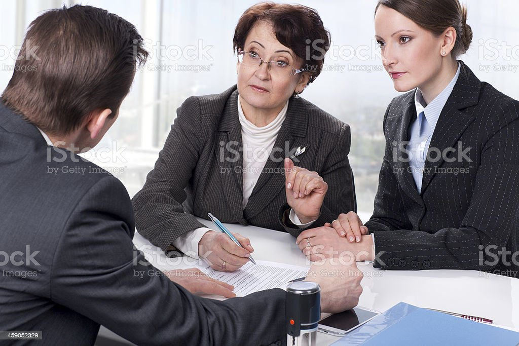 Agent with senior woman and her daughter stock photo