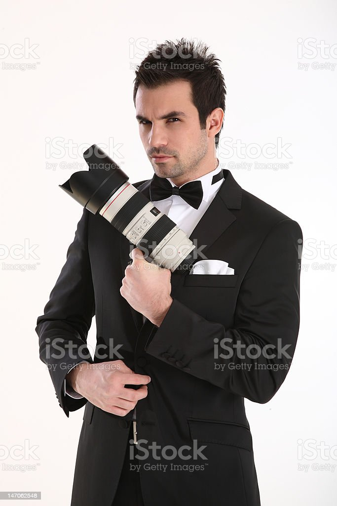 Agent with telephoto lens in hand royalty-free stock photo