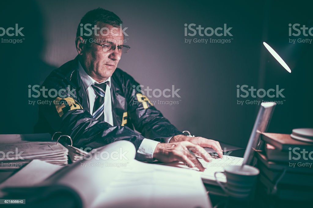 Agent working late stock photo