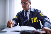 FBI agent writing at his office