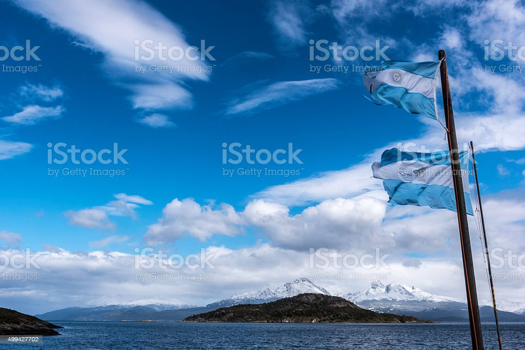 Agentina flag flying over the Andes in Tierra Del Fuego stock photo