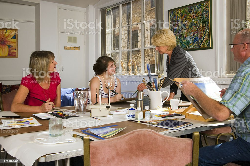 Age-varied group of people in an art class stock photo