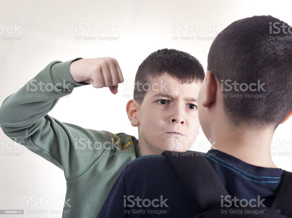 aggresgive boy stock photo