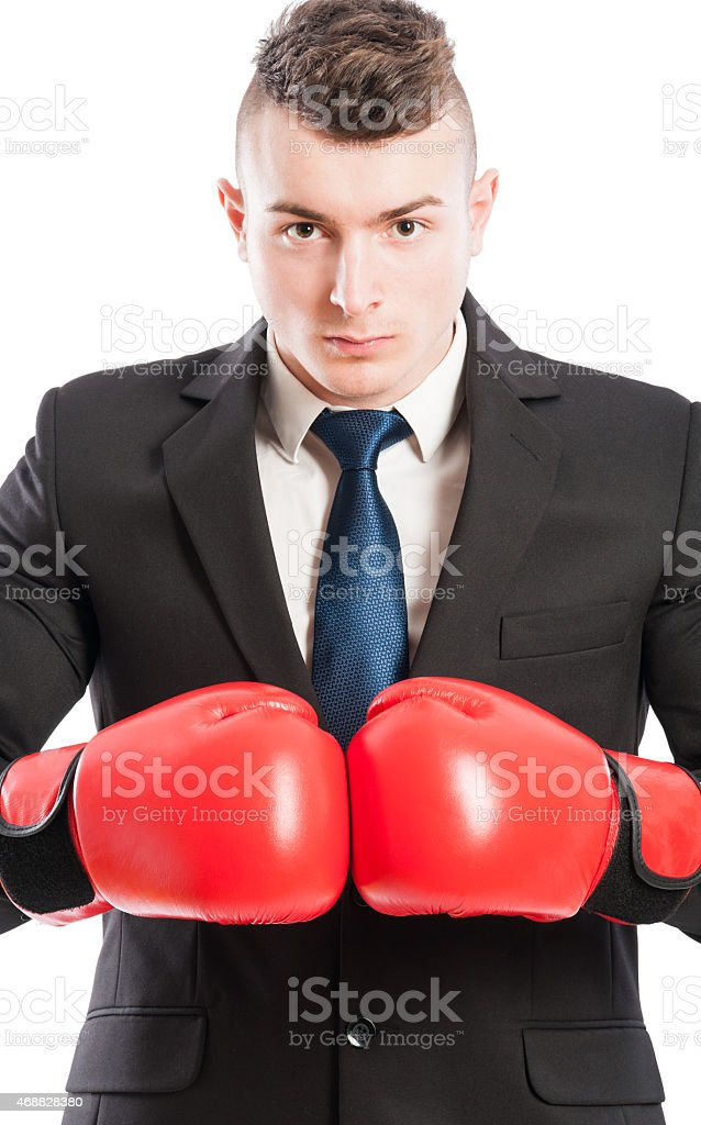 Aggressive and competitive business man stock photo
