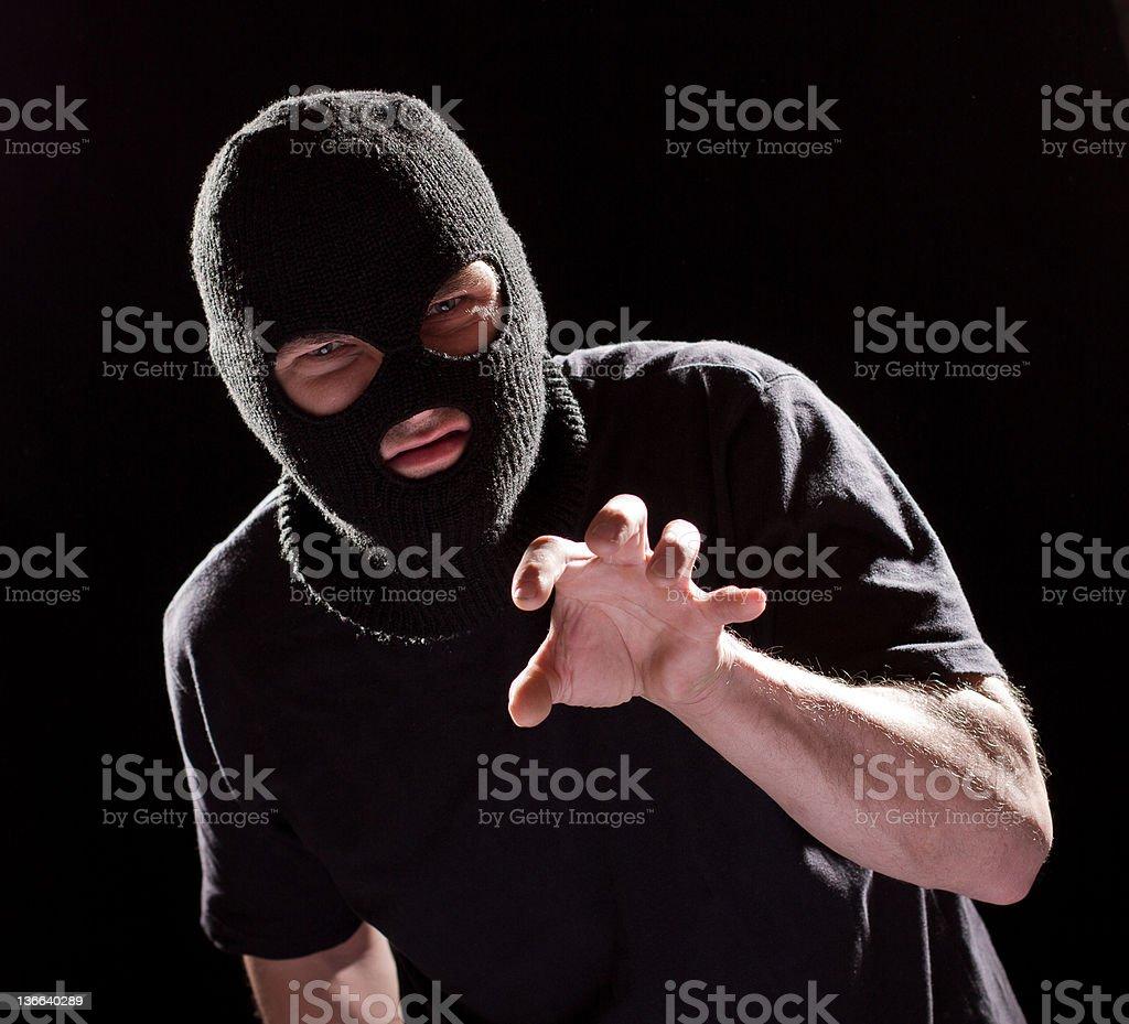 aggressive burglar in black mask royalty-free stock photo