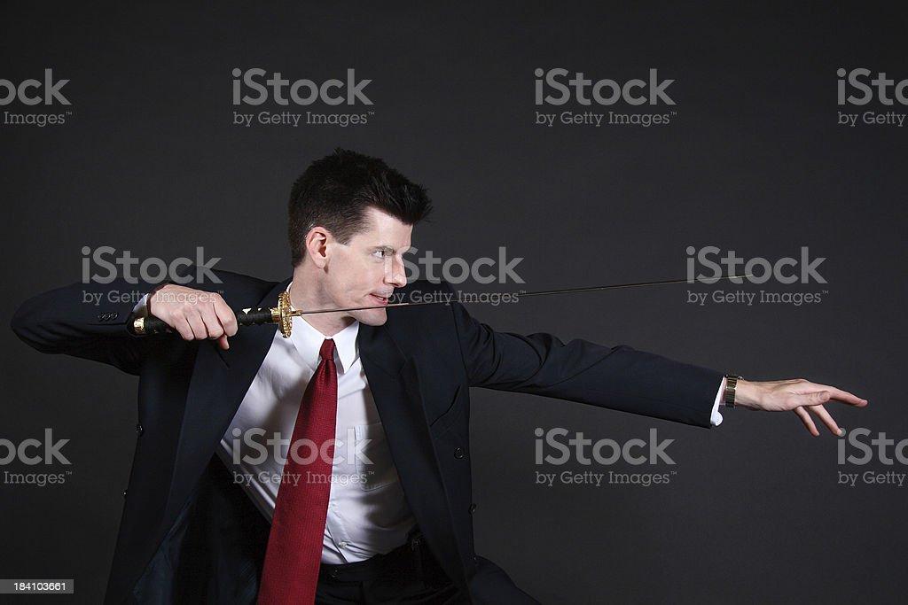 Aggressive Businessman with Sword stock photo