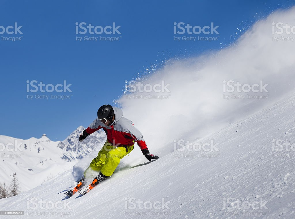 Aggressive downhill skier stock photo