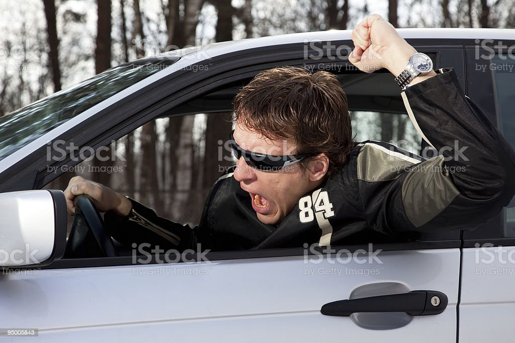 Aggressive driver swearing stock photo