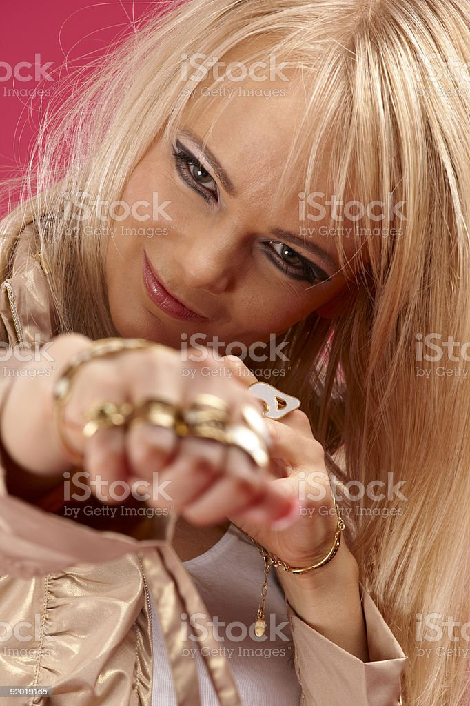 aggressive golden jewelry lady royalty-free stock photo
