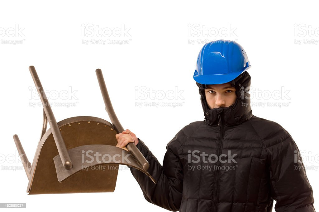 Aggressive hooligan wielding a wooden chair stock photo