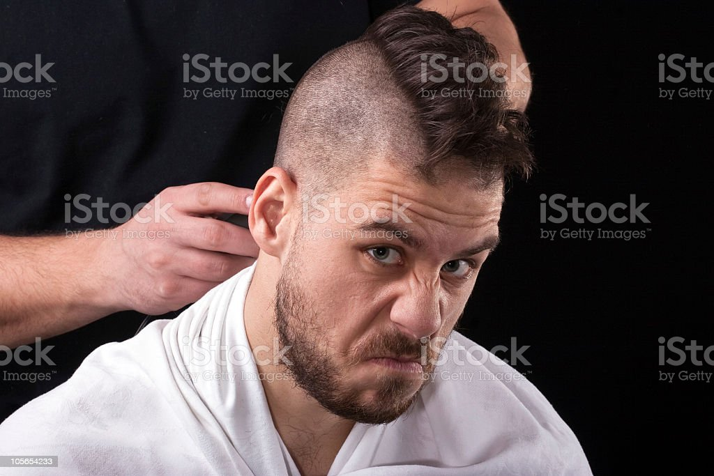 Aggressive  male punker at the hair salon stock photo