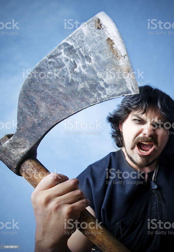 Aggressive Man Holding Large Axe stock photo