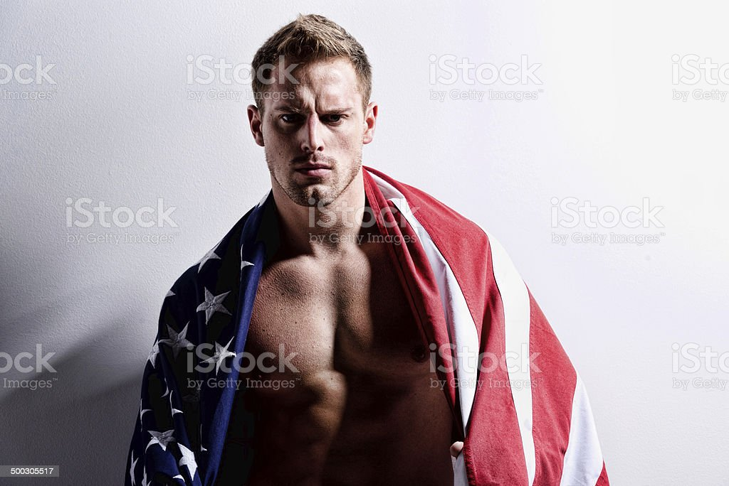 Aggressive man with American flag royalty-free stock photo