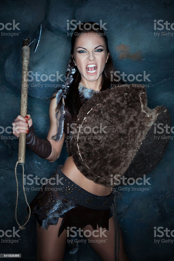 Aggressive medieval woman. stock photo