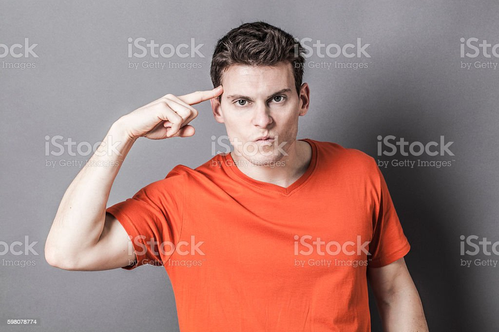 aggressive young sportsman using his temple to express craziness stock photo