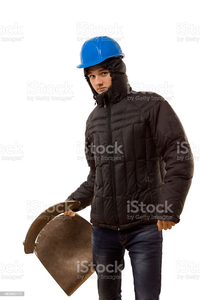 Aggressive young thug holding a wooden chair stock photo