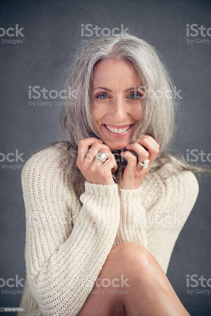 Aging gracefully, beautiful mature woman with silver hair portrait. stock photo