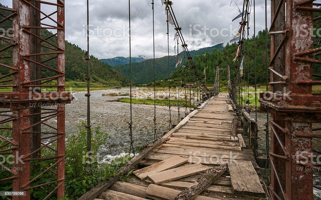 Aging suspension bridge, Sangti, Arunachal Pradesh, India. stock photo