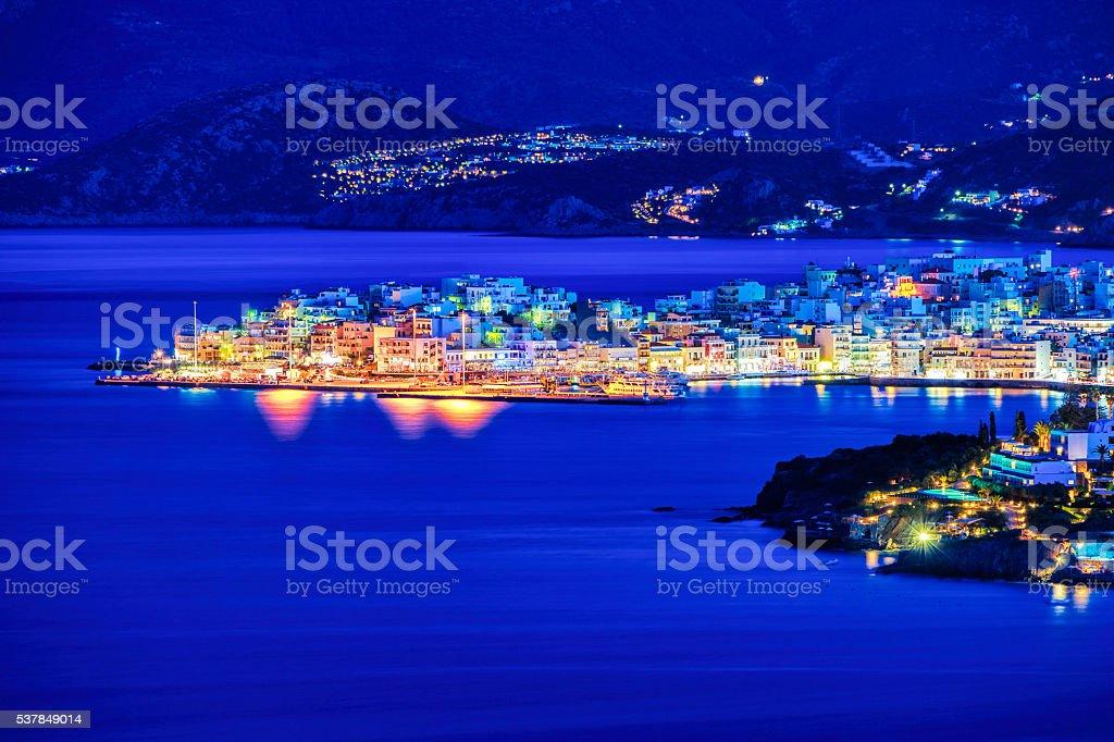 Agios Nikolaos at night, Crete, Greece stock photo