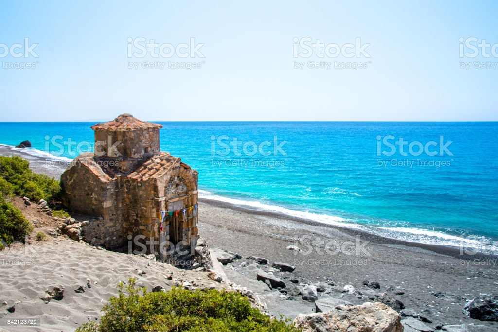 Agios Pavlos beach with Saint Paul church, a very old Byzantine church that was built at the place Selouda, an incredible beach at Opiso Egiali area. stock photo