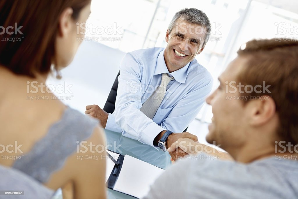 Agreement between financial advisor and client stock photo