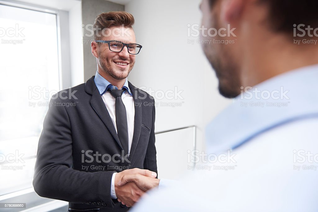 Agreement of two handsome businessmen stock photo