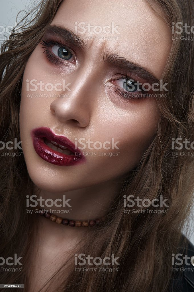 Agressive biker Girl with blue Eyes, wine Lips stock photo