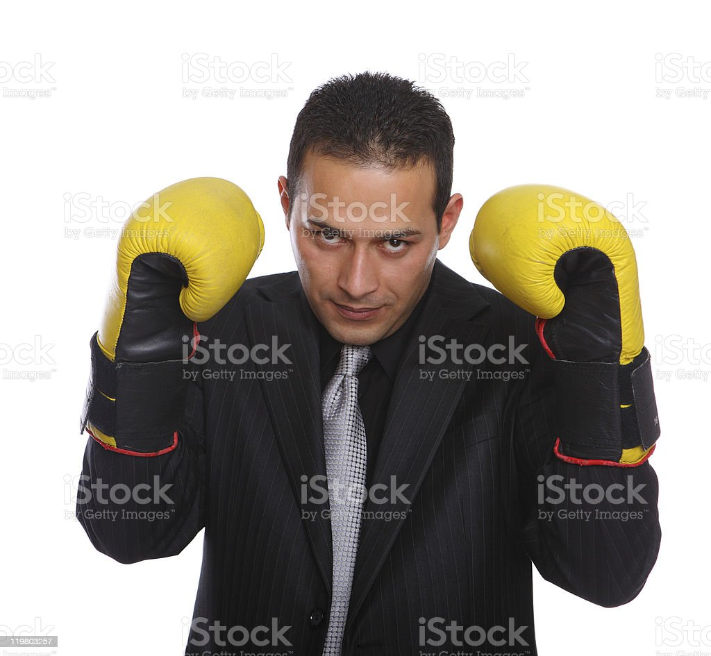 Agressive Businessman with boxing gloves stock photo