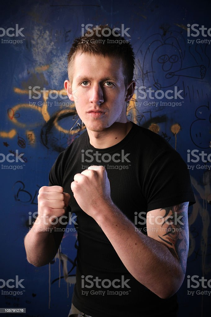 Agressive young man in fighting stance royalty-free stock photo