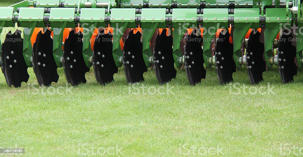 Agricultural Harrowing Machine. stock photo