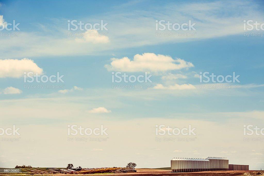 Agricultural Landscape - Farm Equipment On Horizon Under Summer Sky stock photo