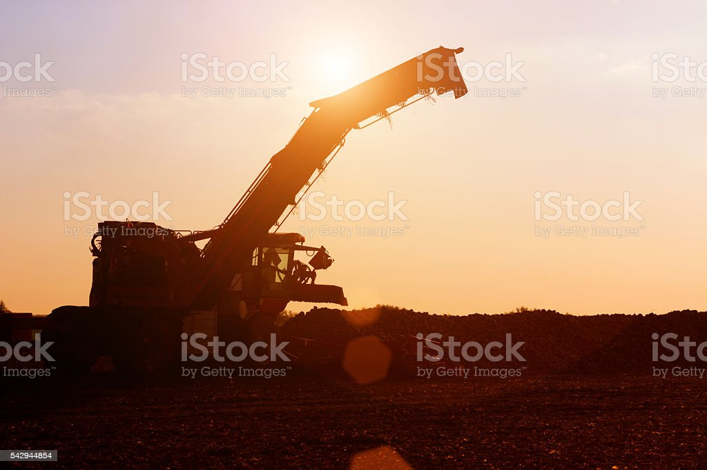 Agricultural machinery in the sunset stock photo