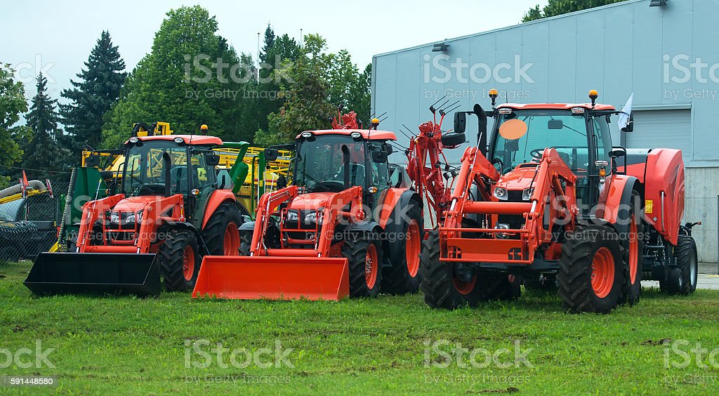Agricultural machinery standing near hangar. stock photo
