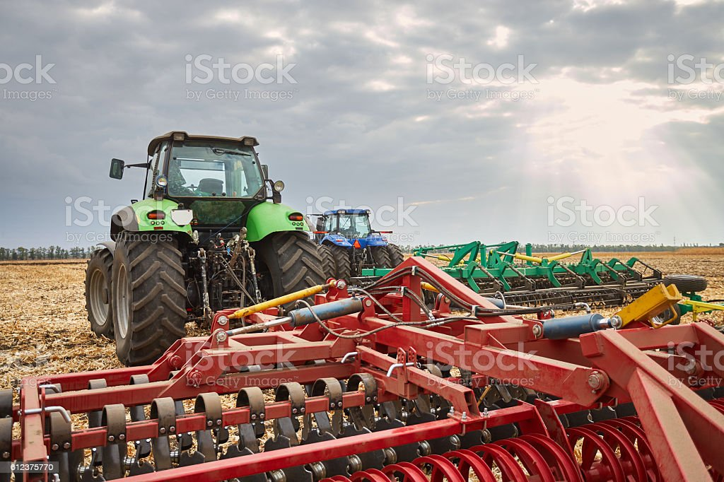 Agricultural machinery work in the field stock photo