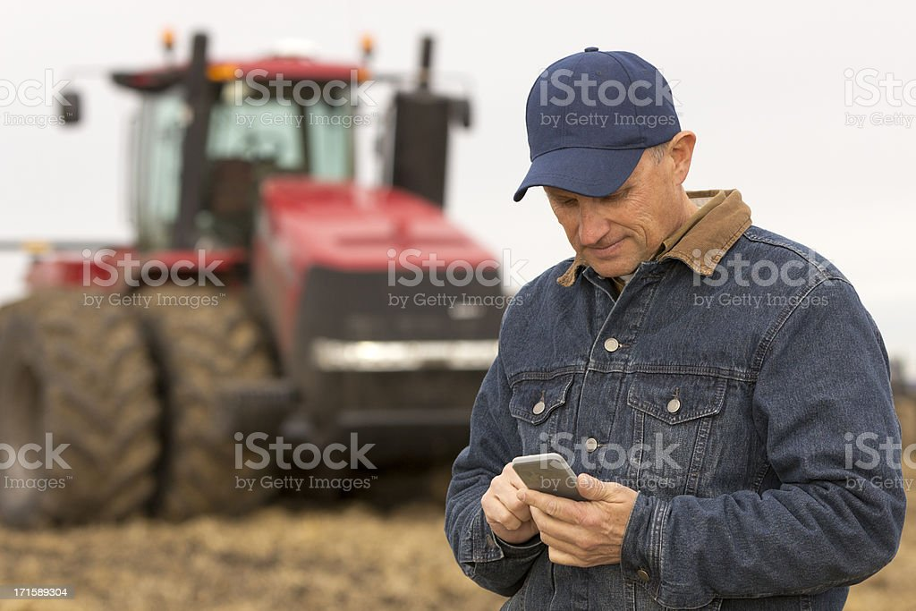 Agriculture and Texting stock photo