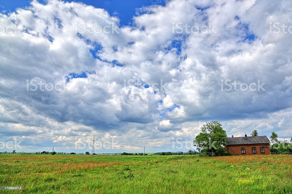 Agriculture Land with Brick Farm House royalty-free stock photo