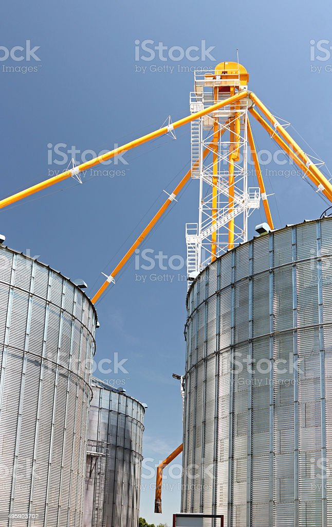 Agriculture: silver metal graineries or silos for storing wheat stock photo